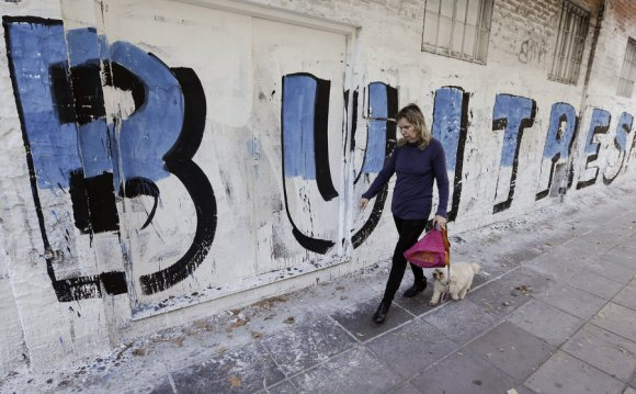 A woman in Buenos Aires walks