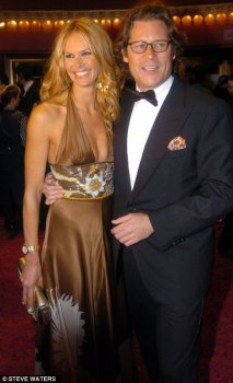 Super rich: Elle Macpherson with ex-love, financier Arpad Busson - with whom she's two kids