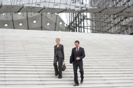 Two businesspeople outside decreasing staircase